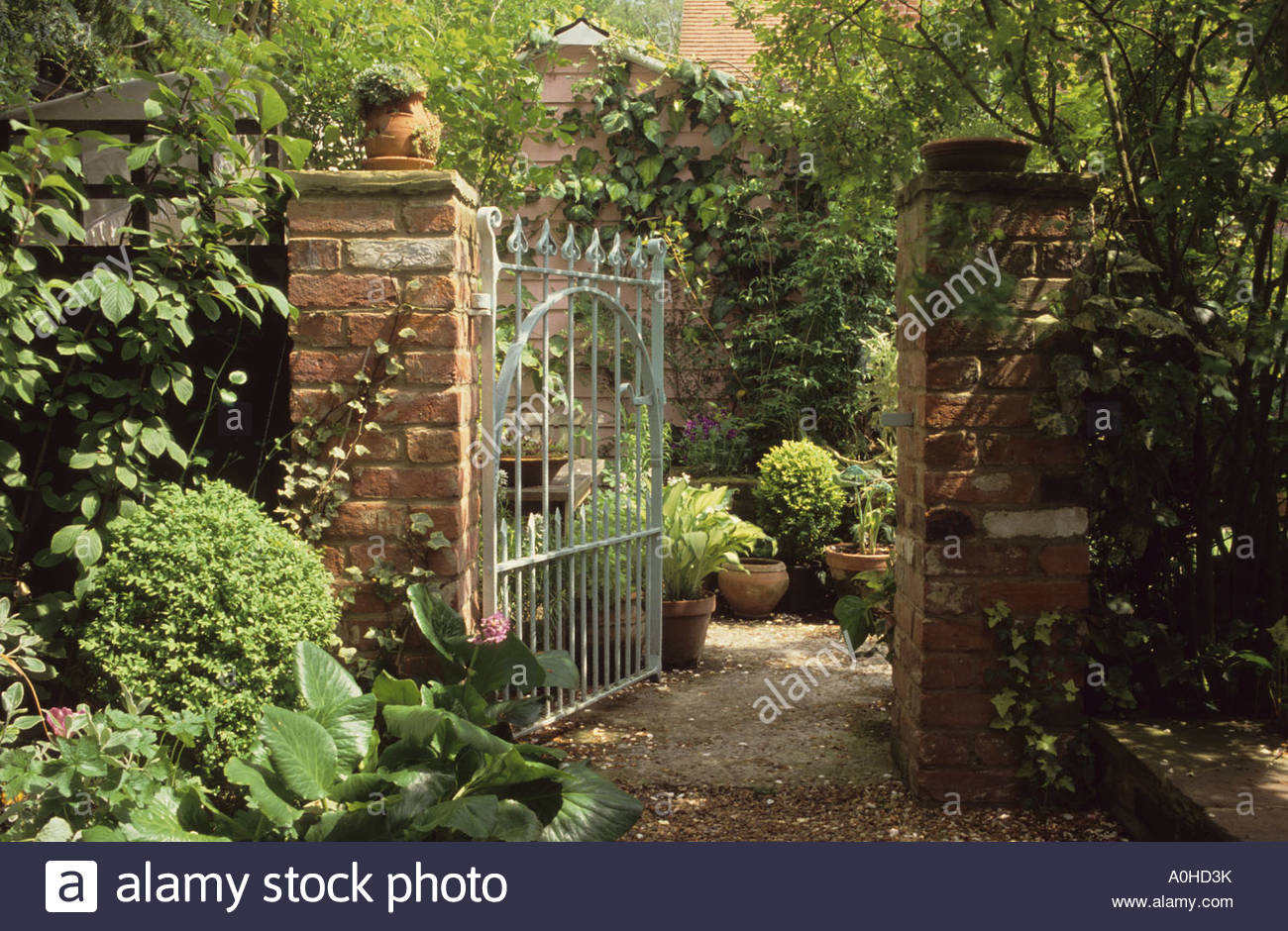 Lime Tree Cottage Surrey Cast iron gate in brick wall View through ...