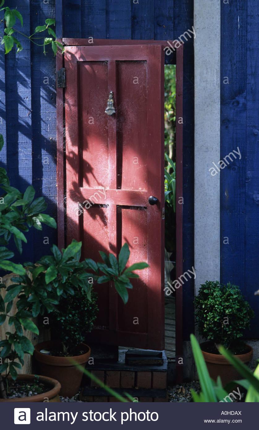 False Door With Mirror Behind Reflecting Garden. Trompe Lu0027oeil