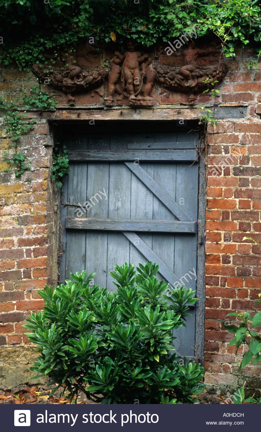 Gentil Hadspen House Somerset Rustic Garden Door Into Walled Garden Terra Cotta  Sculpture
