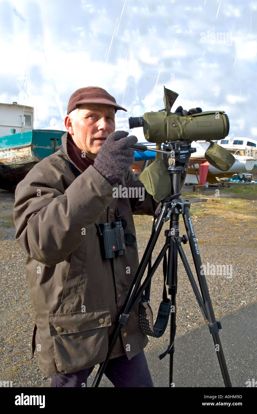 A Birdwatcher with his spotting scope - Stock Image