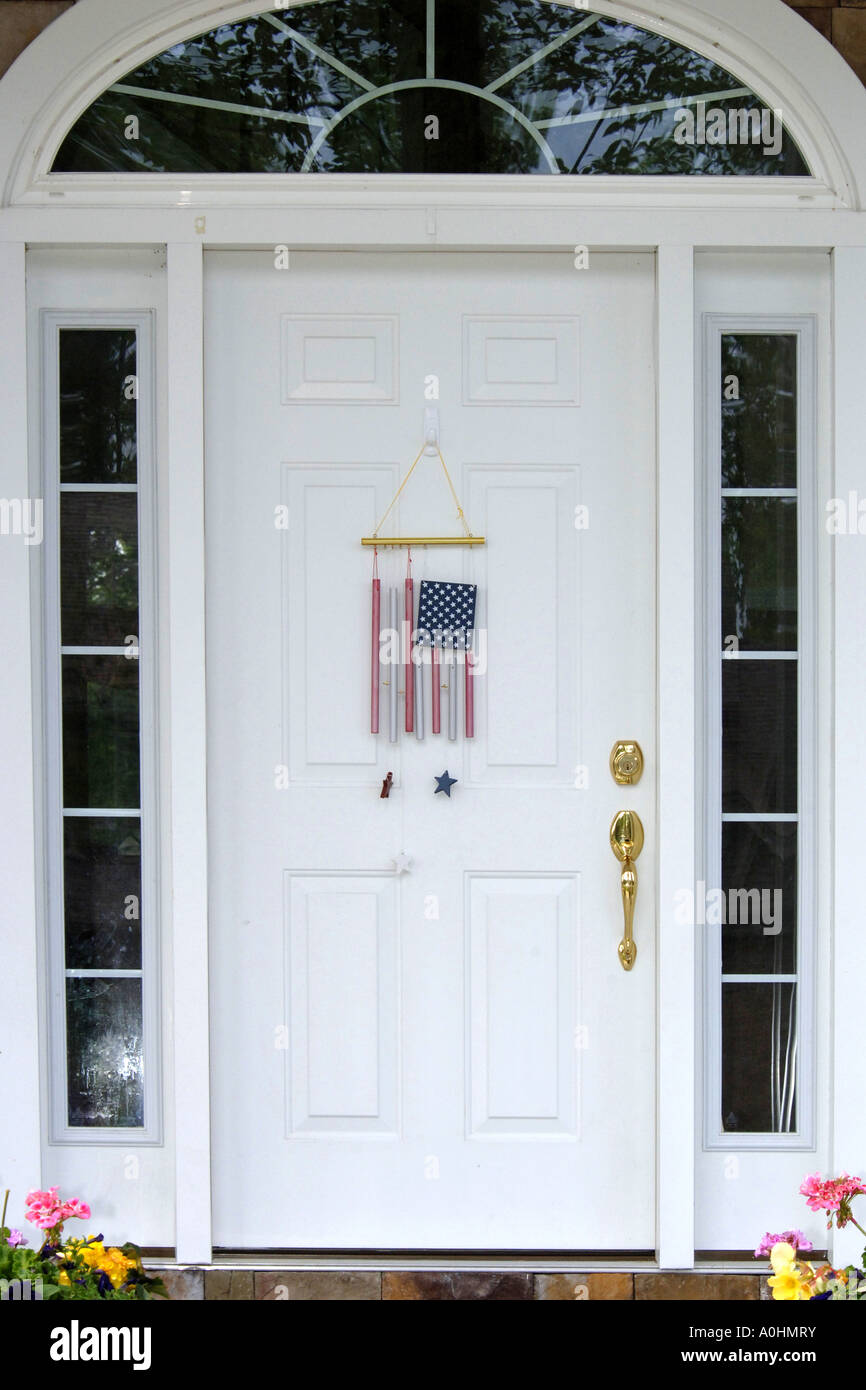 American flag wind chimes hanging on a white entry door & American flag wind chimes hanging on a white entry door Stock Photo ...
