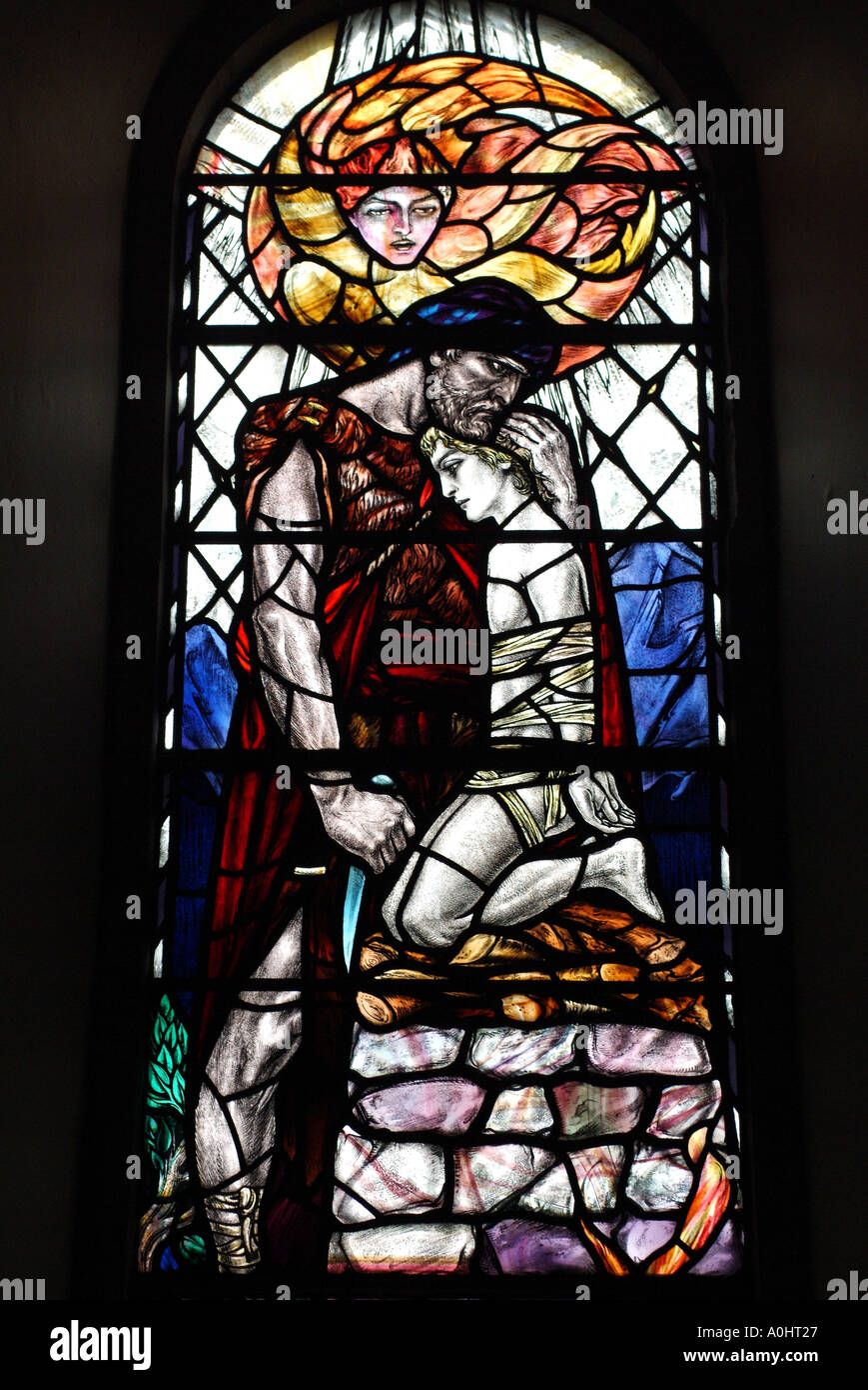 Stained glass window depicting the sacrifice of Isaac in Abercorn Church, West Lothian, Scotland, UK. - Stock Image