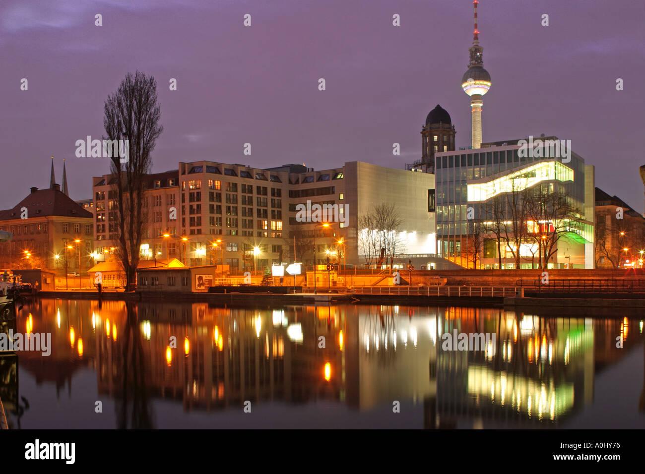 Netherlands Embassy architect  Rem Koolhaas river Spree Alex TV tower twilight - Stock Image