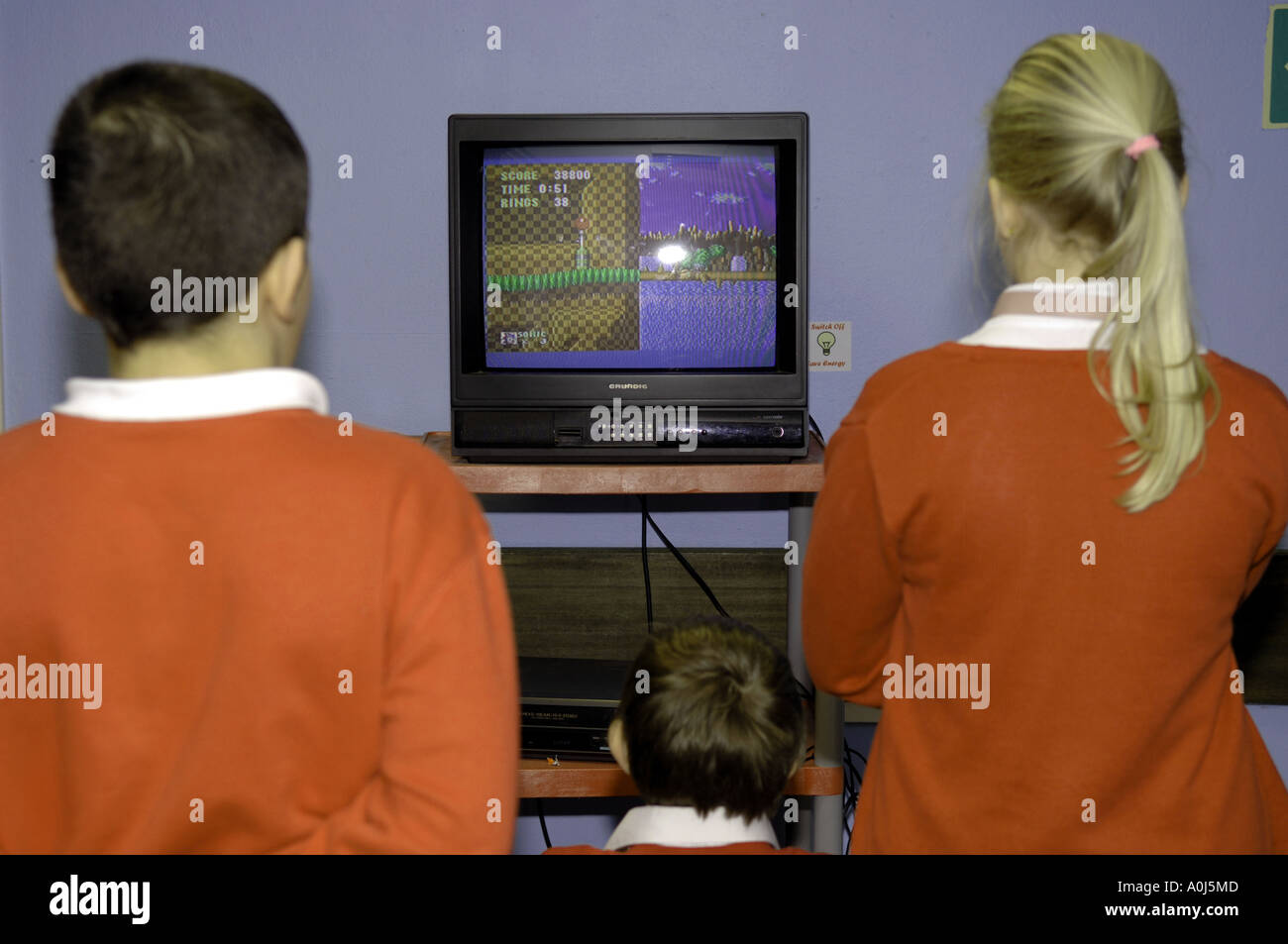 boys and girl playing and watching sonic the hedgehog, retro