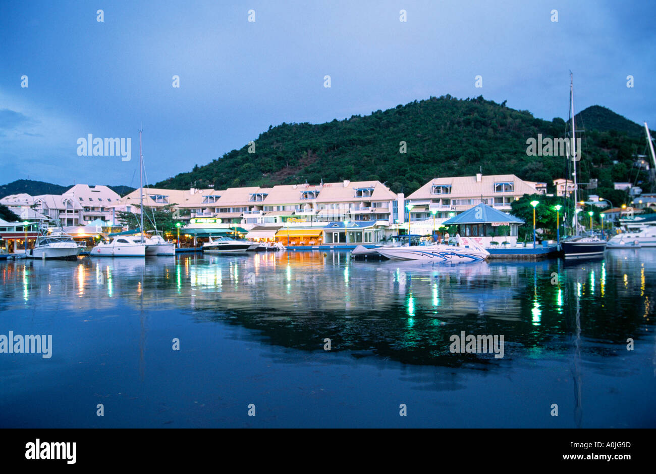 Marigot Saint Martin French West Indies Sailing boats dusk pier with restaurants - Stock Image