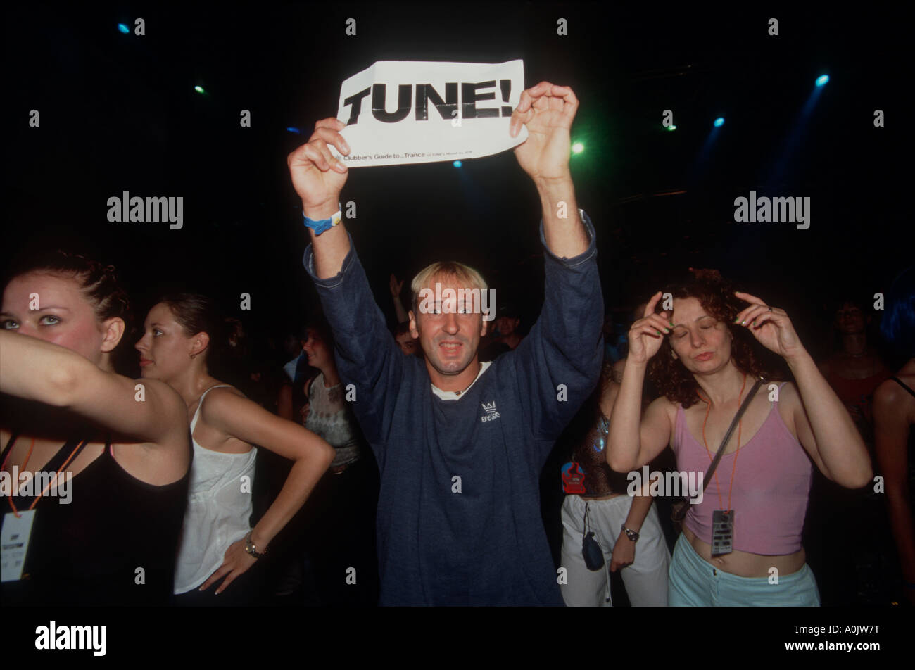 Clubber holding up Tune signat Lynx Voodoo eclipse party, August 1999 - Stock Image