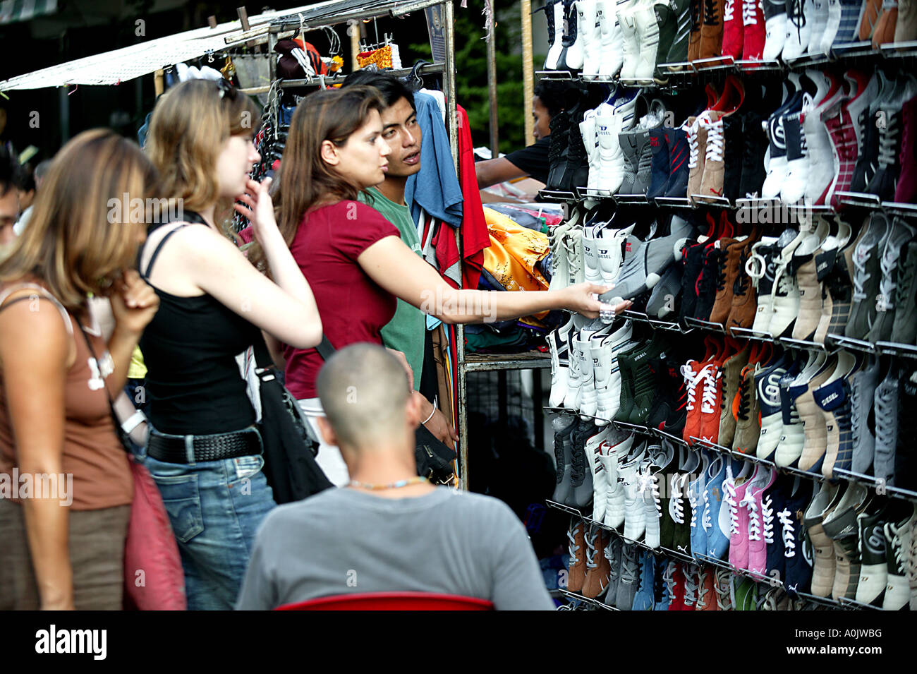 Shopping for trainers in Khao San Road in Bangkok Thailand This area attracts tourists especially backpackers from - Stock Image