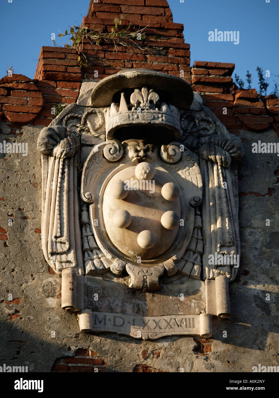 The de Medici family emblem on an old warehouse along the Arno river in Pisa Tuscany Italy - Stock Image