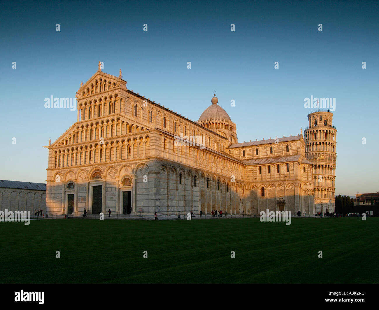 Duomo and the famous Torre pendente leaning tower in late afternoon sunlight Pisa Tuscany Italy Campo dei Miracoli - Stock Image