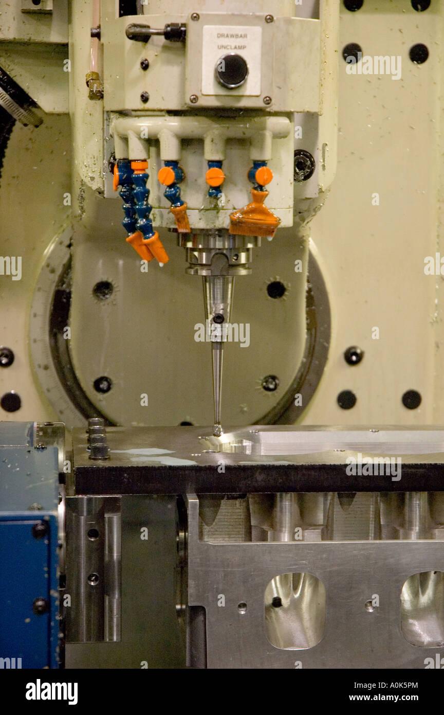P31 210 Detroit Engine Shop - Liquid CNC Cutter (9) - Stock Image