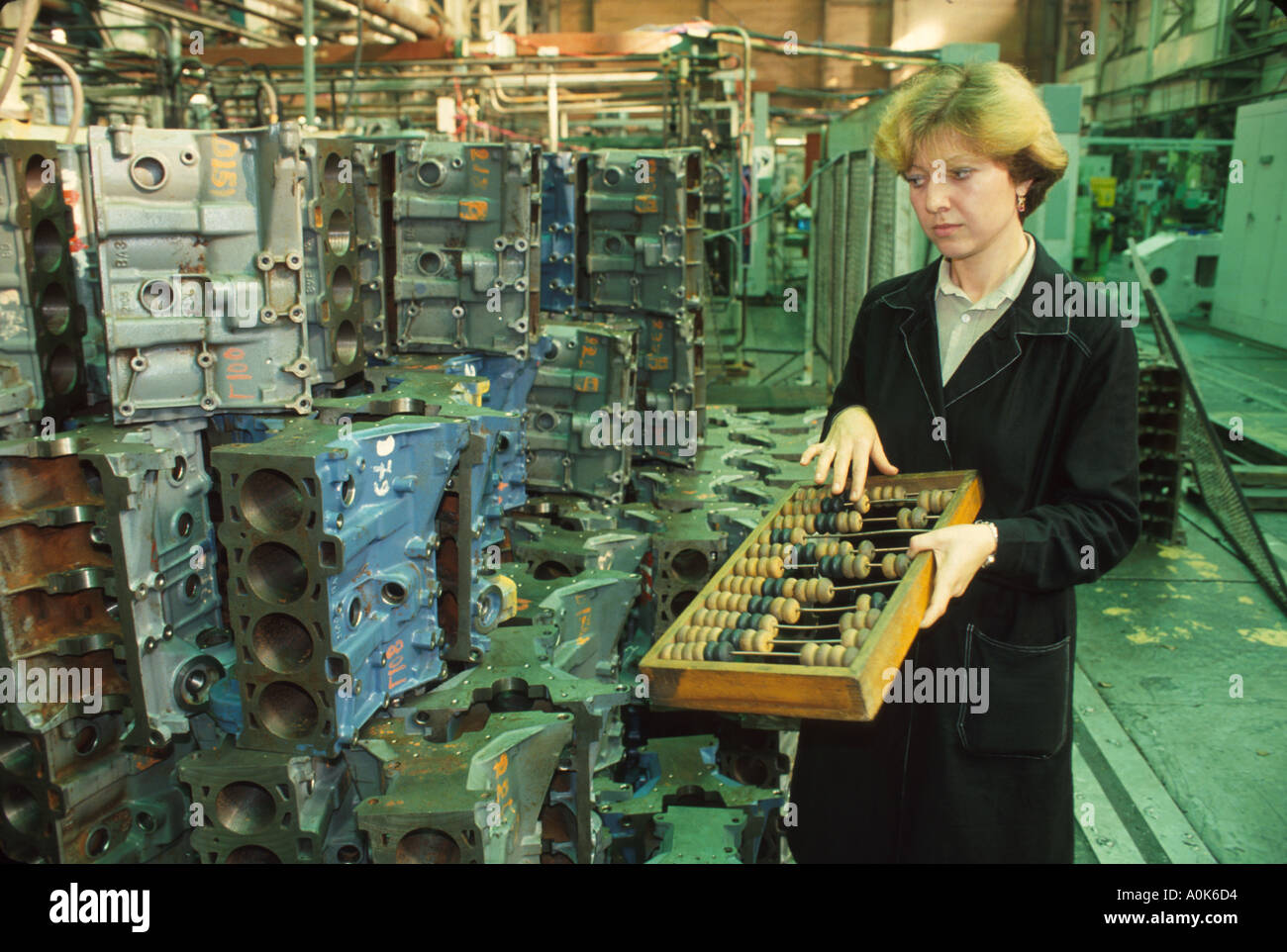 Russia former Soviet Union Moscow privatized machine shop worker using abacus - Stock Image