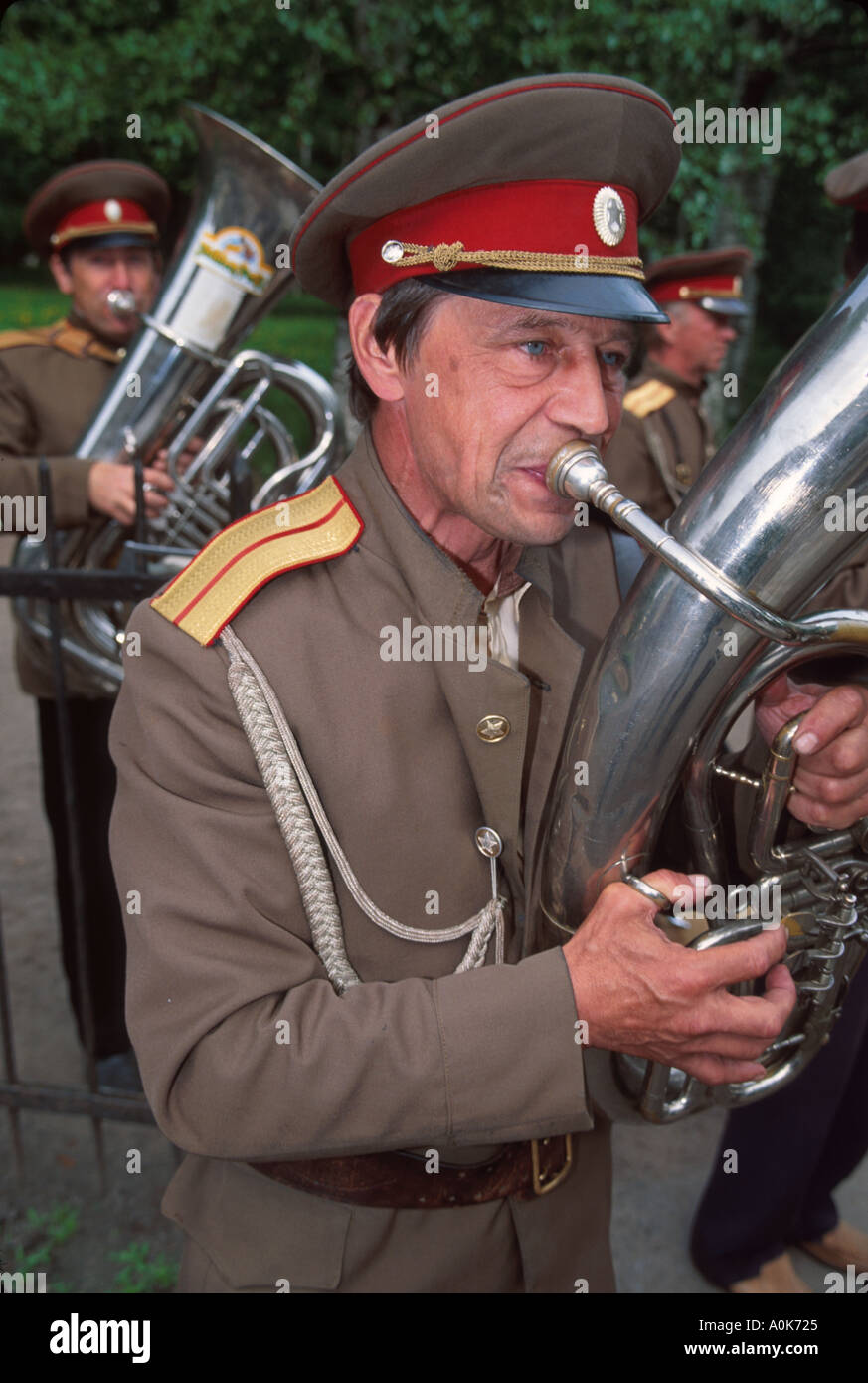 Russia former Soviet Union Pushkin member of band plays for tips near Catherine Palace - Stock Image