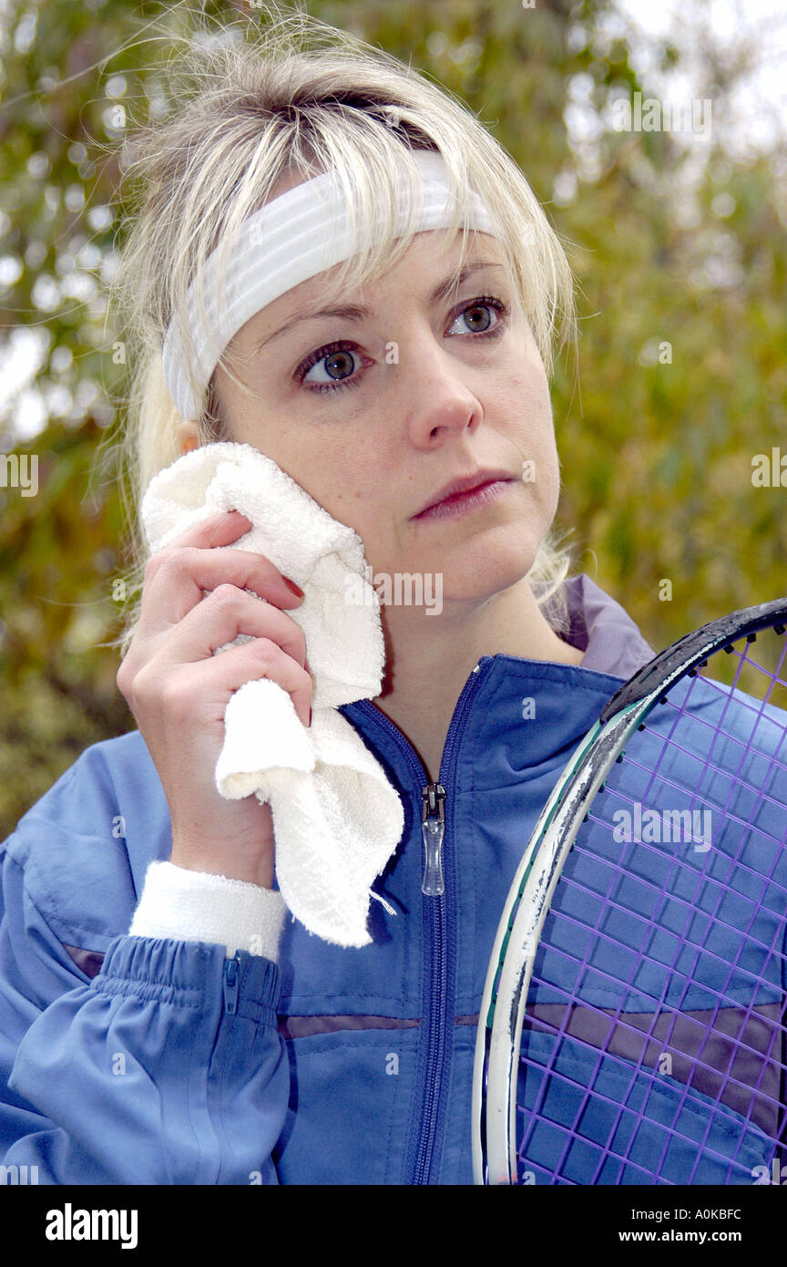 Female After Working Out at Tennis - Stock Image