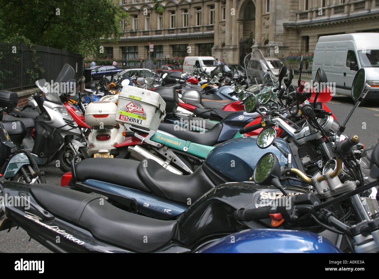 Row of Motorbikes parked in Finsbury Circus Cily of London GB UK - Stock Image