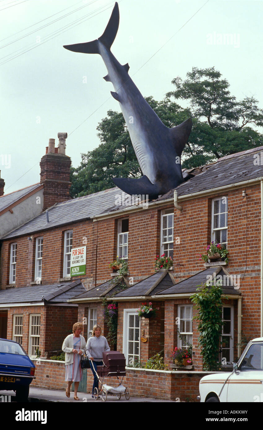 A shark sculpture in the roof of a house in New High Street, Headington, Oxford, Oxfordshire UK - Stock Image