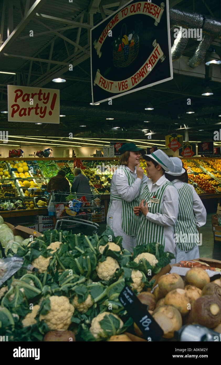 Staff in the fruit and vegetable section of an ASDA supermarket in Dewsbury,Yorkshire, England - Stock Image
