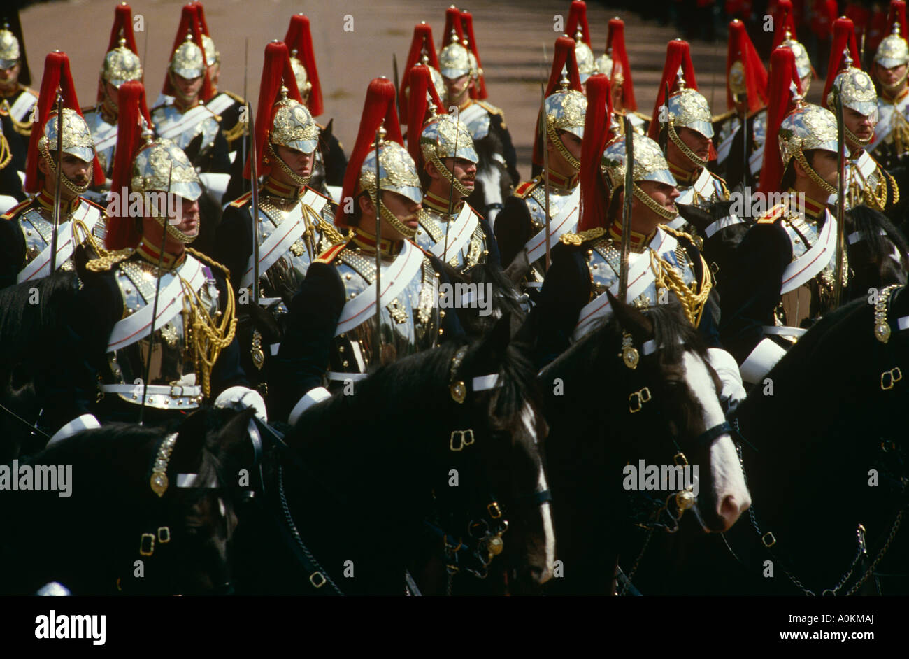 Household cavalry parade along The Mall in London at the annual Trooping the Colour ceremony in June - Stock Image