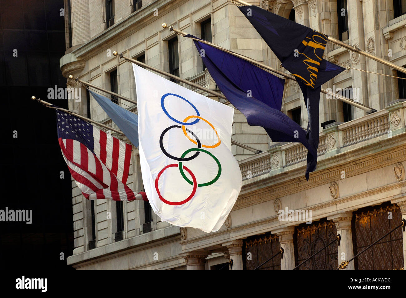 The Olympic flag flies with others at the Plaza Hotel The Evaluation Commission of the International Olympic Commission IOC is arriving in New York City for a four day assessment of the city s bid for the 2012 Olympic Games NYC2012 is decorating the city with banners and flags to greet the members of the IOC - Stock Image