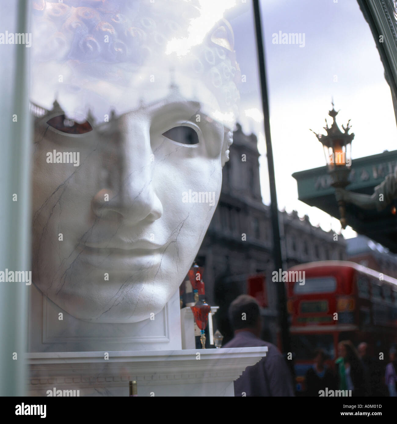 Reflection of a Greek God face in a London shop window, Picadilly, England UK - Stock Image