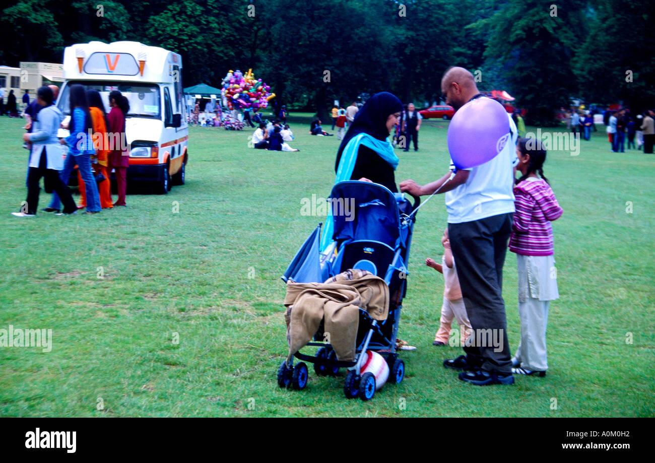 Eid Mela - Eid Fair Muslim Families Enjoying Celebrations in Birmingham West Midlands England - Stock Image