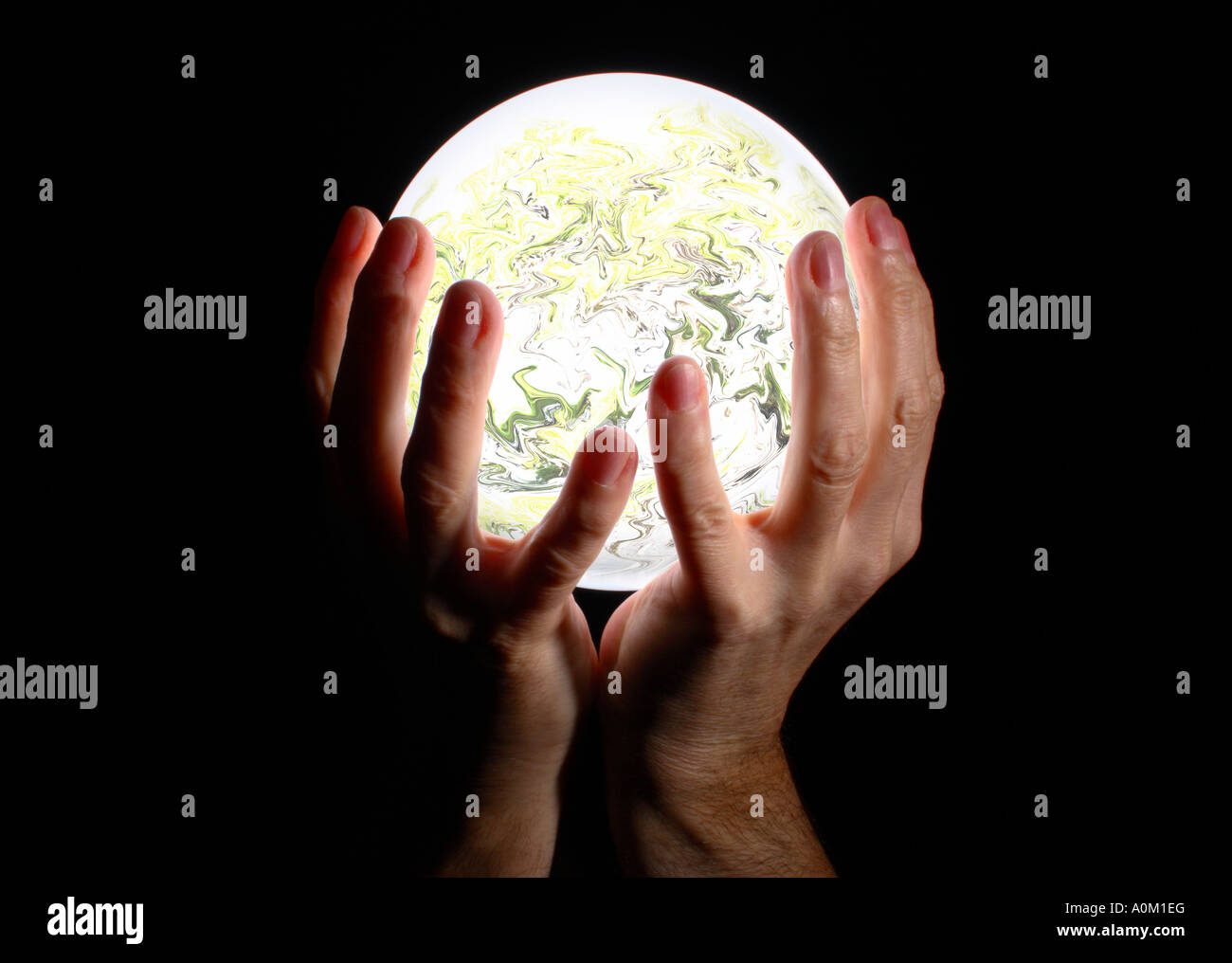 Holding a crystal ball. - Stock Image