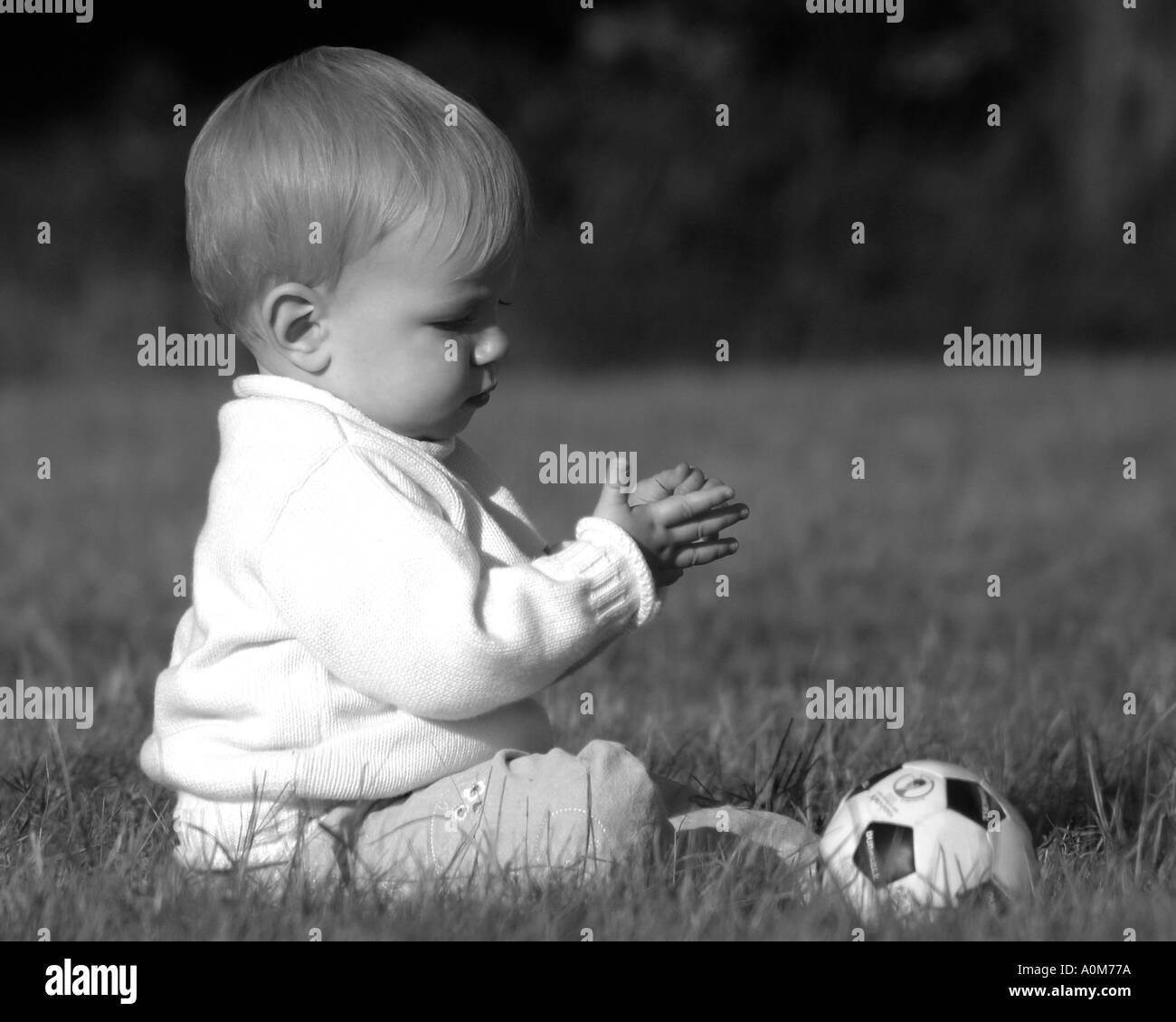 little girl with football - Stock Image