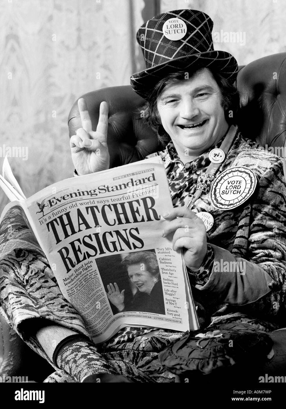Screaming Lord Sutch at his home reading news of Mrs Thatchers resignation. - Stock Image