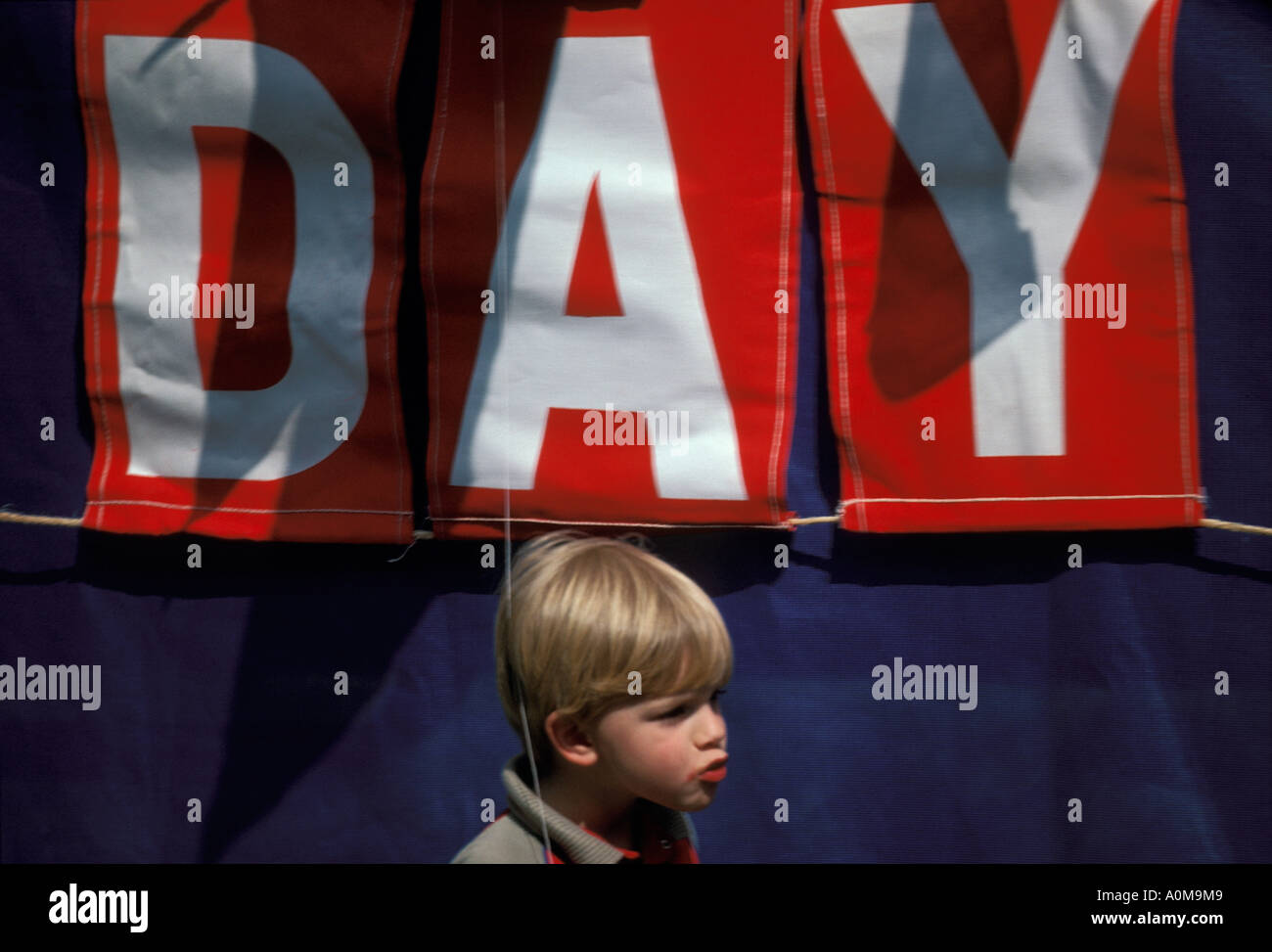 1 one young boy in front of speakers platform Loyalty day parade small town america Stock Photo