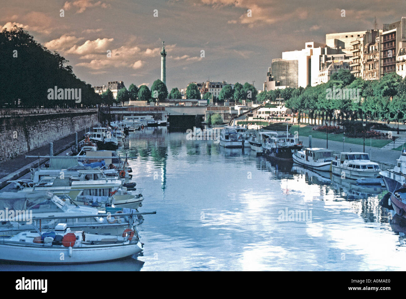 Paris France 'St Martin's Canal' la Bastille with the 'July Column' Boats on Waterway in 'City Center' - Stock Image