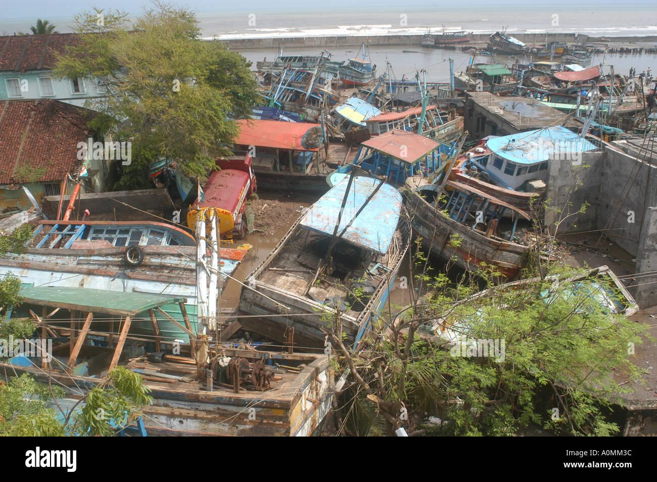 Boats on land by natural disaster Tsunami earthquake on sea floor Nagapattinum Velankanni Tamil Nadu Indian Ocean India - Stock Image