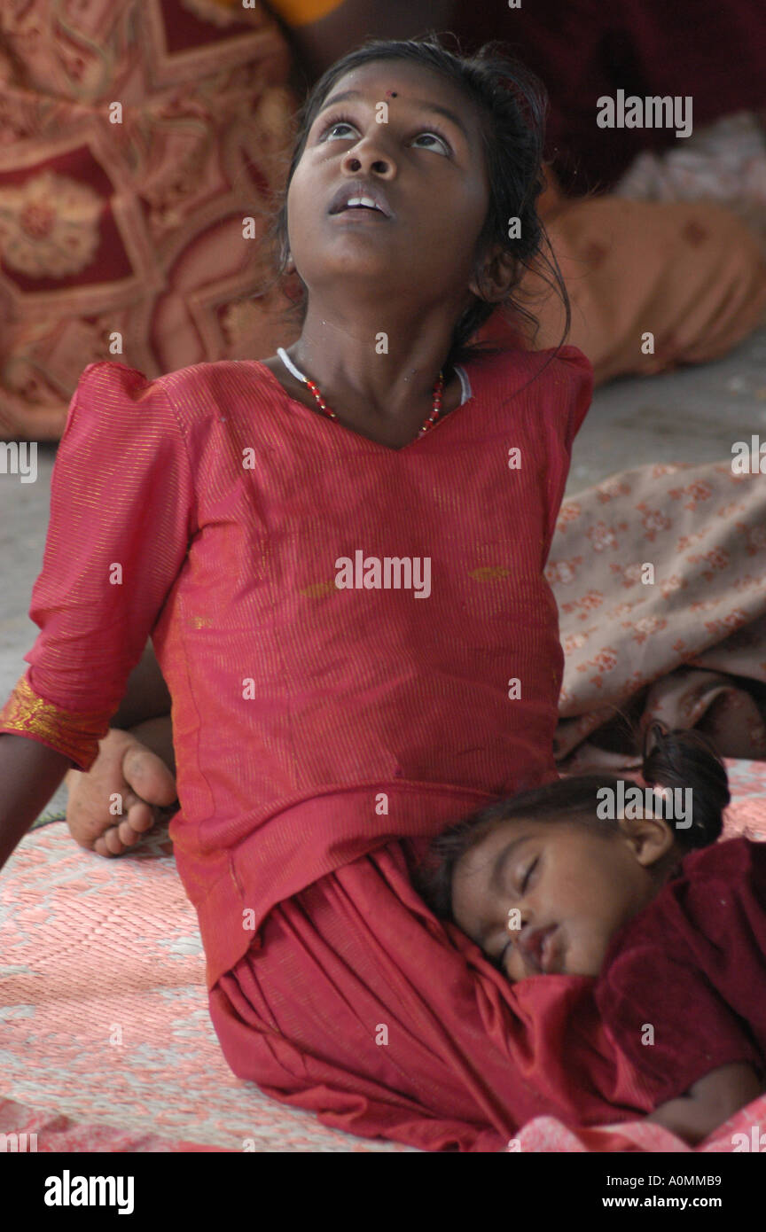 Sisters waiting for parents after natural disaster Tsunami earthquake on sea floor Nagapattinum Velankanni Tamil Nadu India Asia - Stock Image
