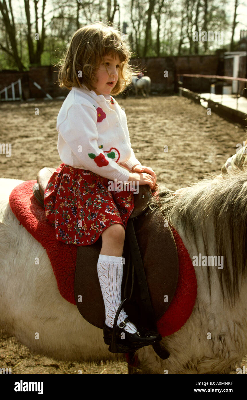 Cheshire Tatton Park children young girl having riding lesson - Stock Image