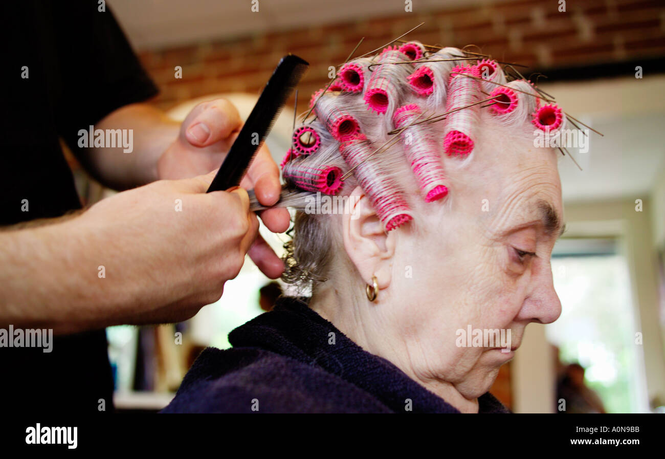 Lady 70s 80s at traditional hairdressers England UK Stock Photo
