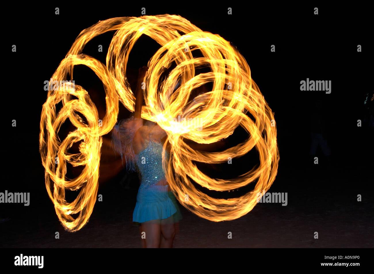 fire spinning at full moon party Ko Pha Ngan Thailand - Stock Image