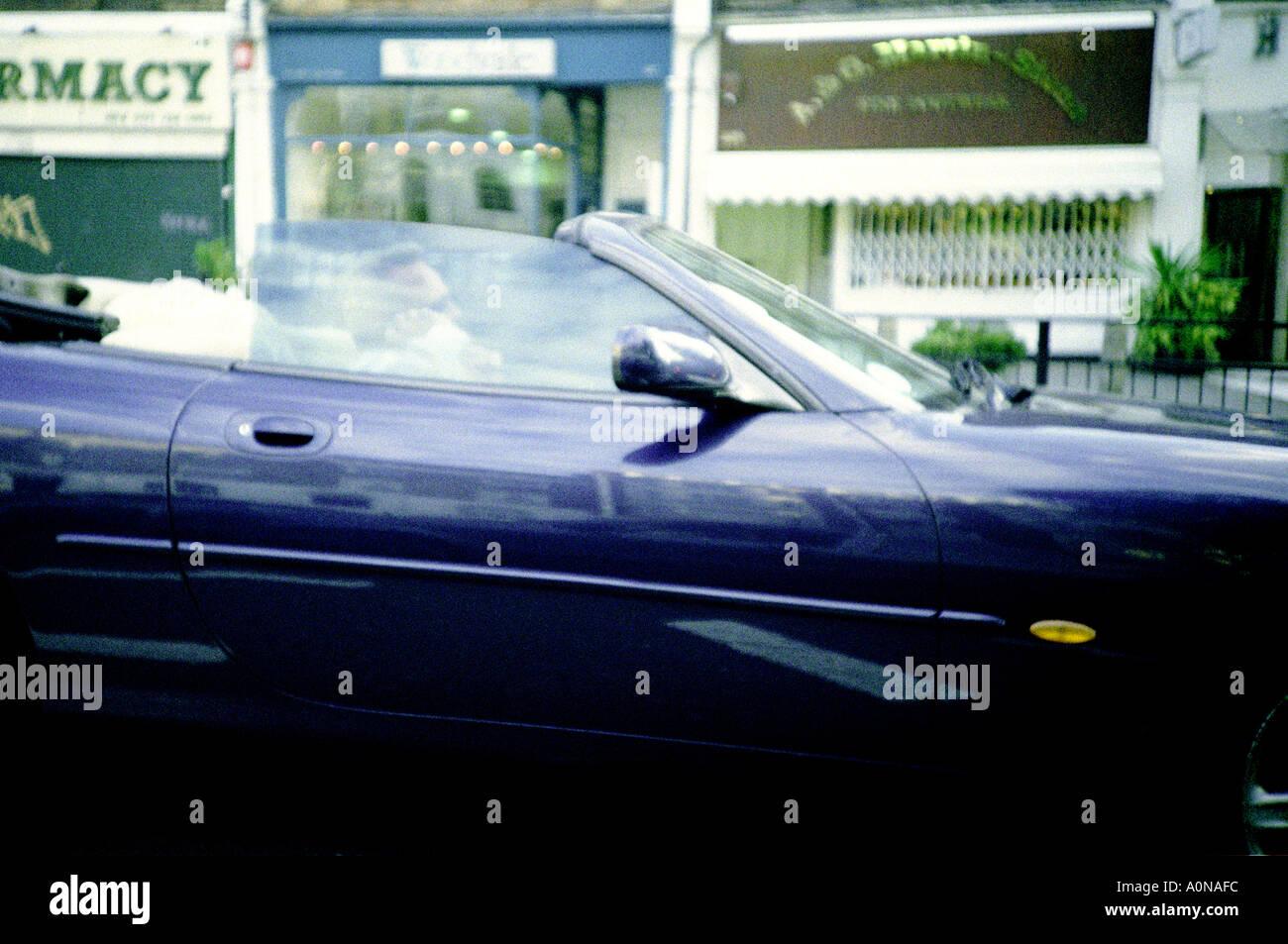 Smooth geezer in posh car - Stock Image