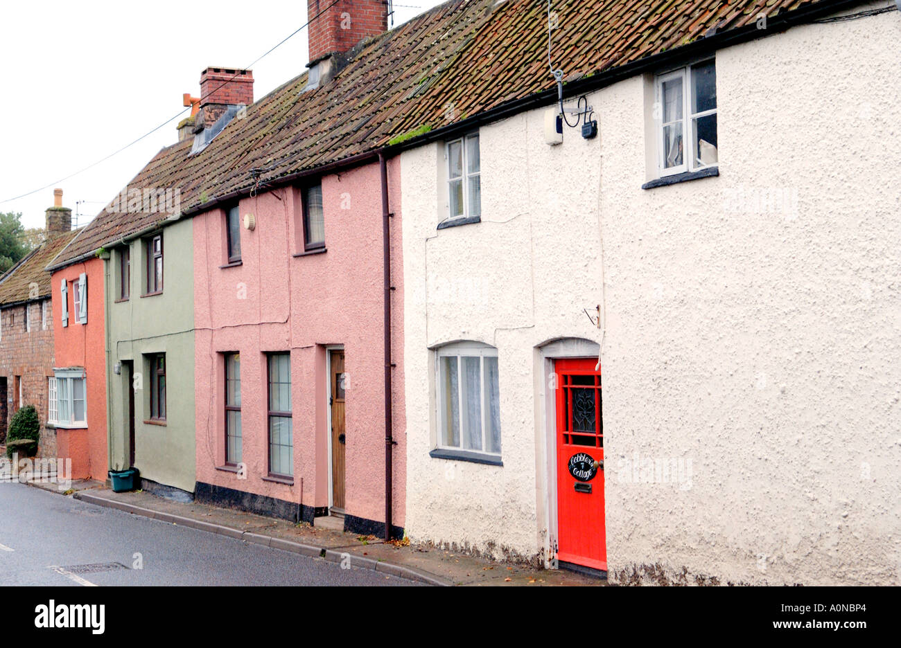 Row of country cottages in village of Chew Magna near Bristol England UK - Stock Image