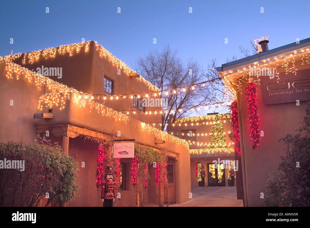 Christmas Lights On Retail Adobe Building In Santa Fe New Mexico Stock Photo Alamy