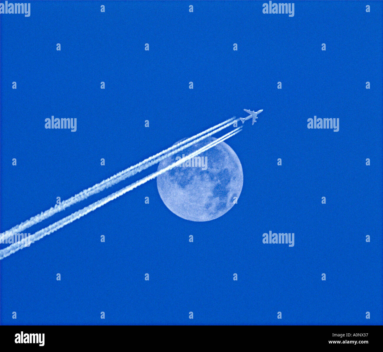 Jet Stream And Full Moon - Stock Image