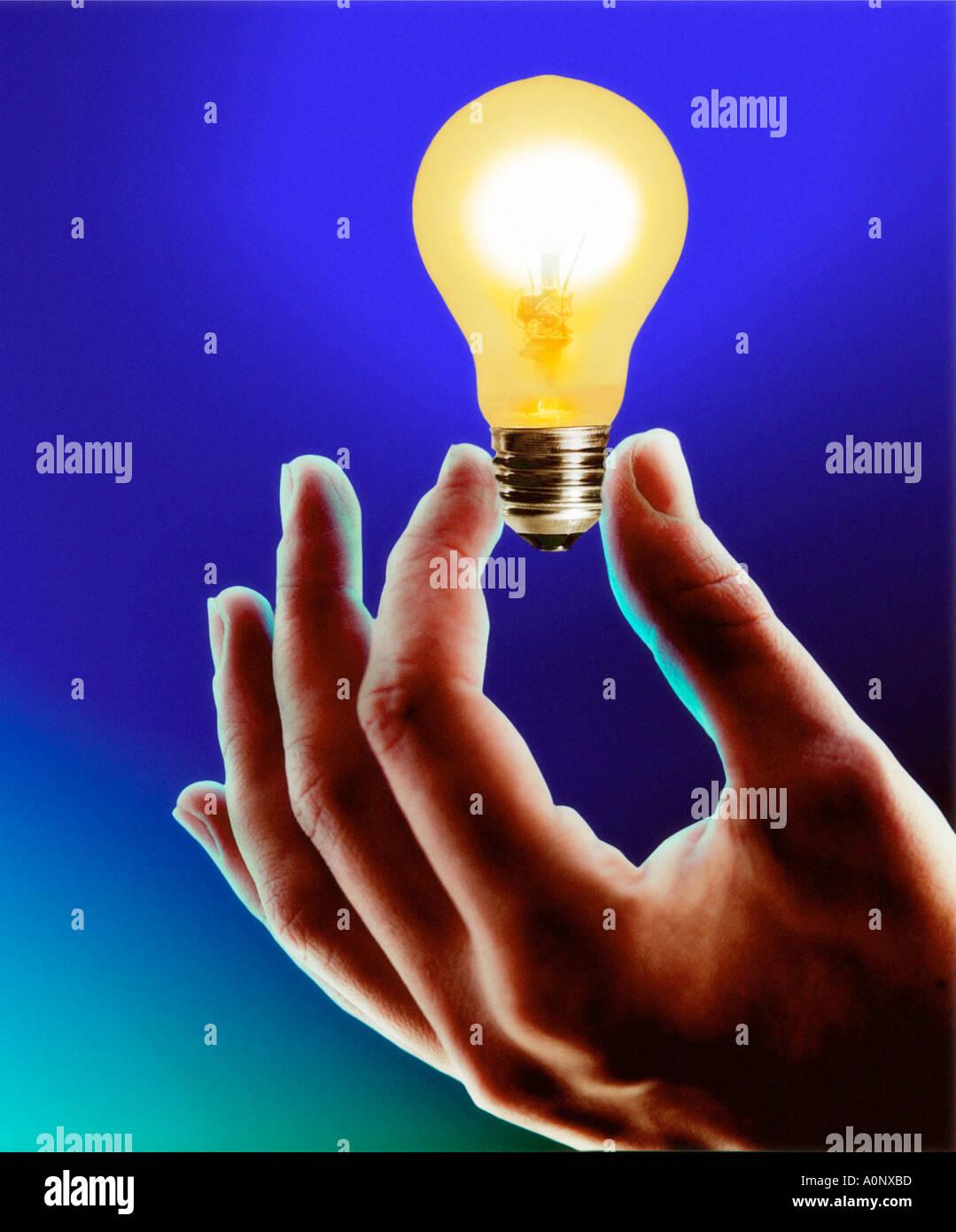 Hand Holding Light Bulb Stock Photo