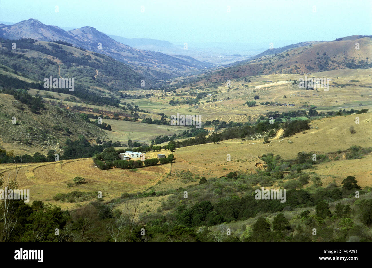 A small modern farm overlooking a valley in the hilly countryside south of Mbabane Swaziland southern Africa - Stock Image