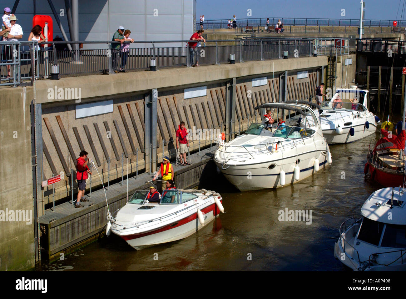 Sea going pleasure boats entering one of the locks on the Cardiff Bay Barrage Wales UK GB Stock Photo