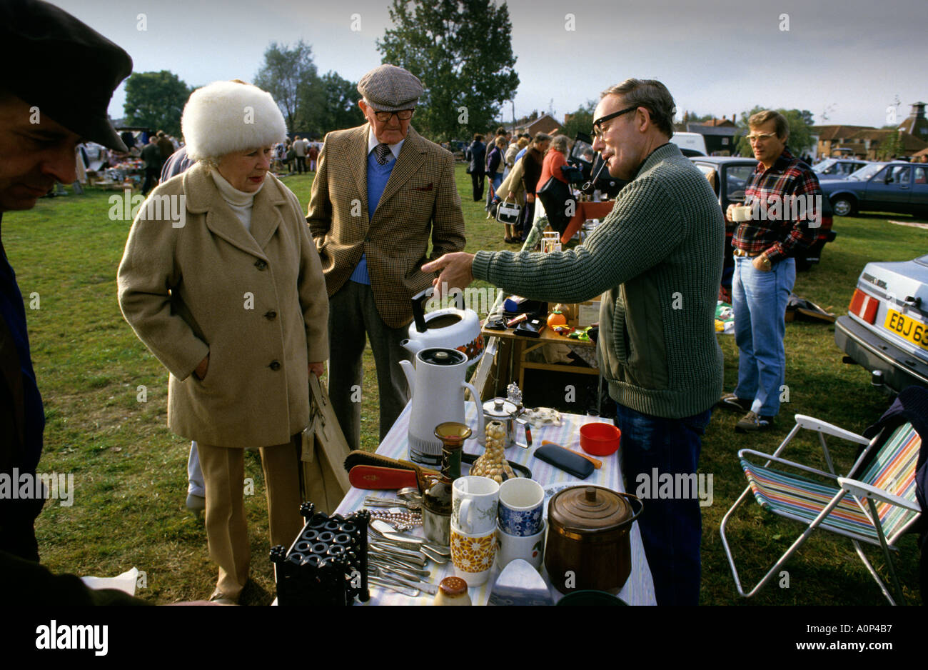ENGLAND CAR BOOT SALE  PHOTOGS FATHER SELLING SO MODEL RELEASED - Stock Image