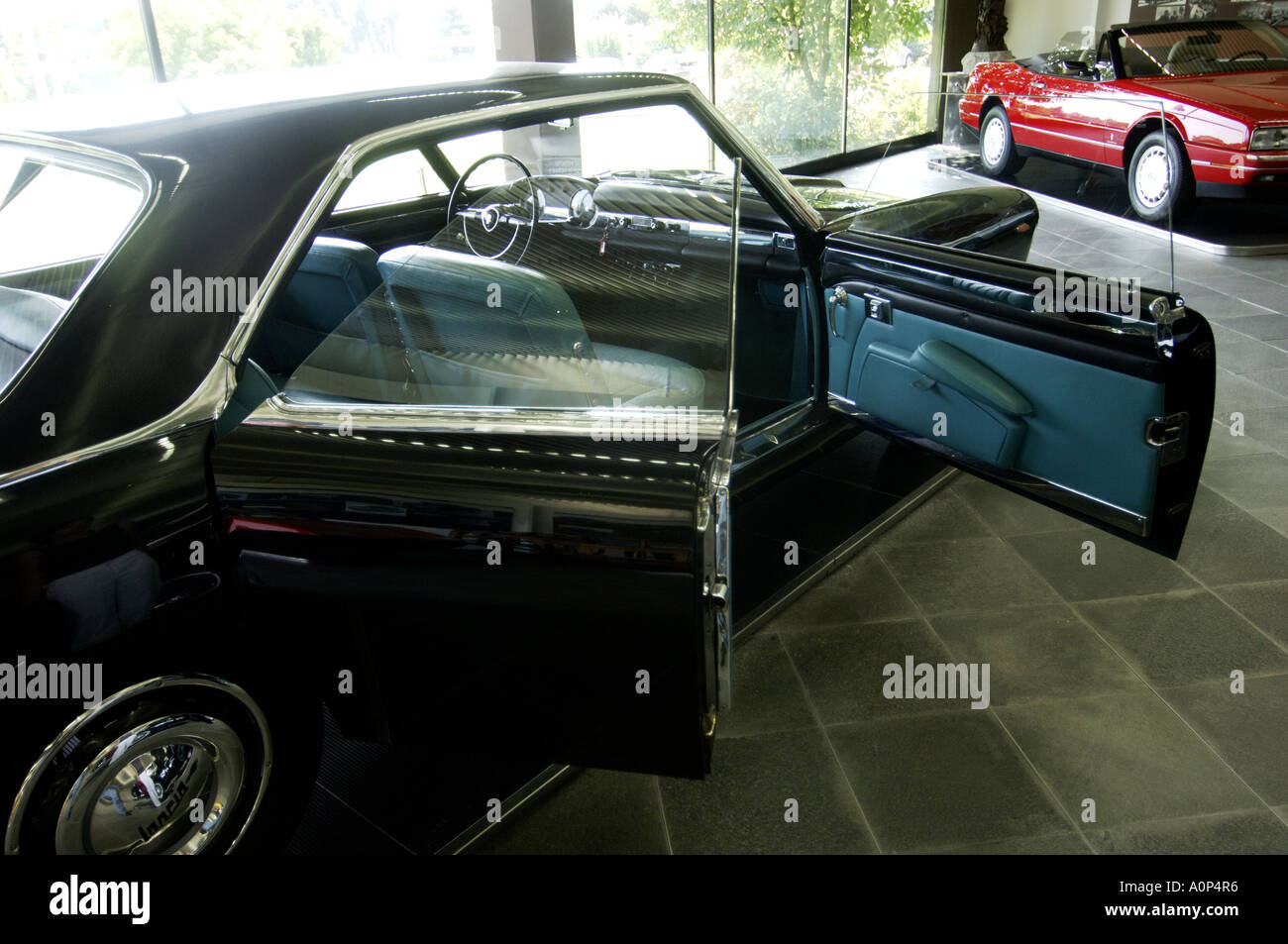 Turin an old model Lancia in the showroom of auto designer company Pinin Farina - Stock Image