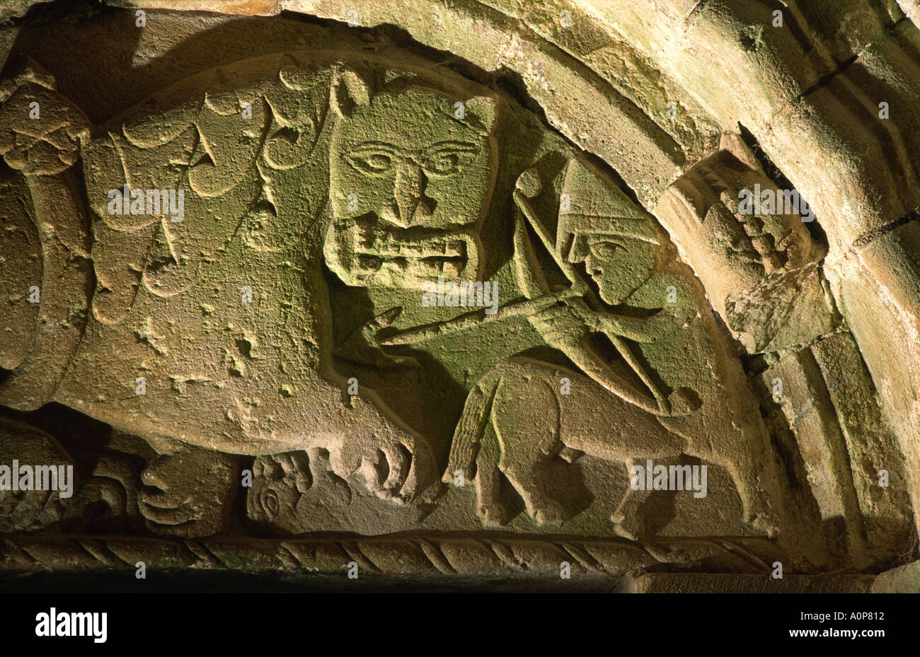 Tympanum above north door of Cormac's Chapel, Rock of Cashel. Norman centaur kills Celtic Christian lion. Co. Tipperary, Ireland - Stock Image