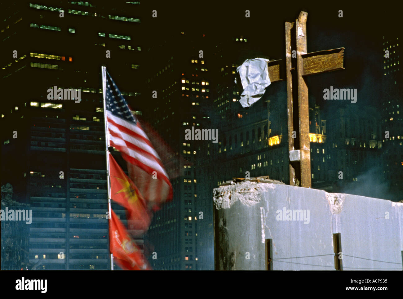 Among the debris of the World Trade Center attack in New York City after the September 11, 2001 terrorist attack a cross was raised by ironworkers. - Stock Image