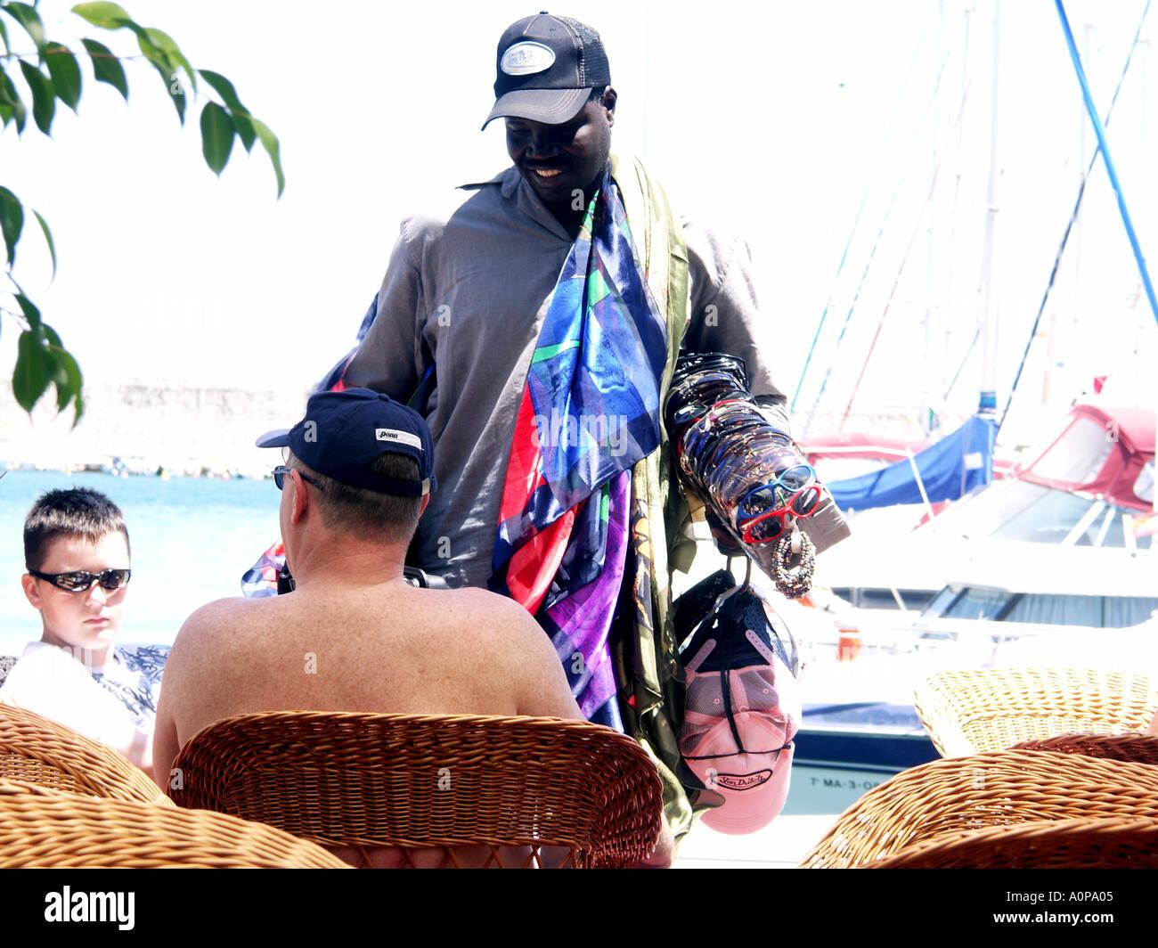 black lookie lookie man selling base ball caps sunglasses watches rh alamy com lookie lookie i got hooky lookie lookie here comes cookie