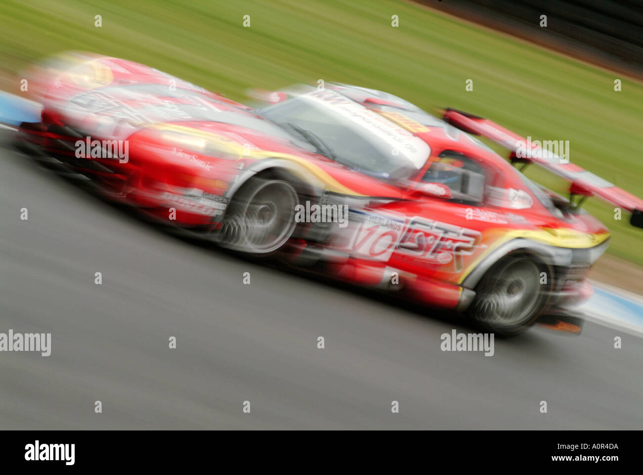 dodge viper racing car race motor sport auto risk win lose fast speed power blur motion movement power engine competition - Stock Image