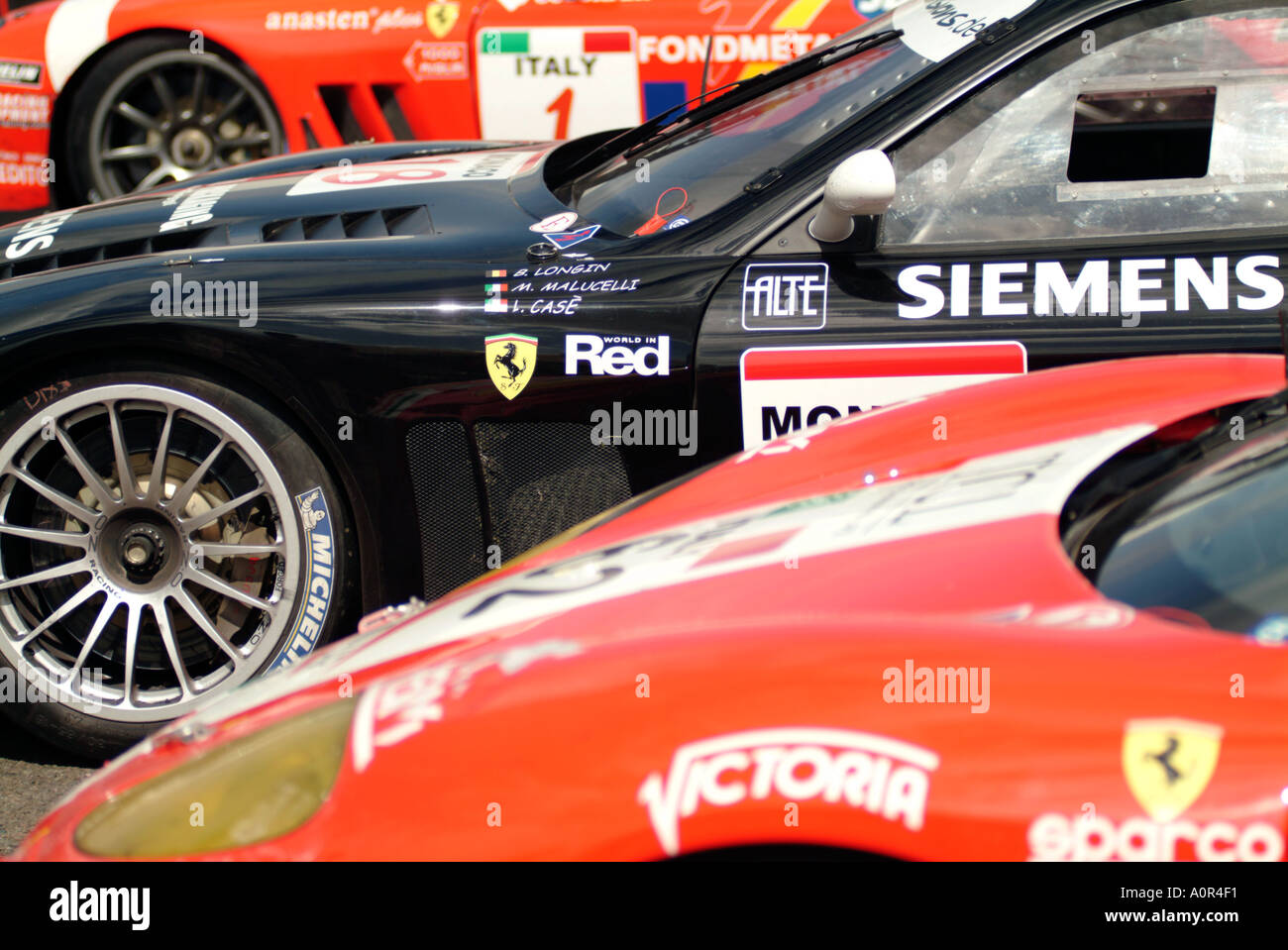 ferrari sponsor advertising wheel tyre slick racing car race motor sport auto risk win lose fast speed power prancing - Stock Image