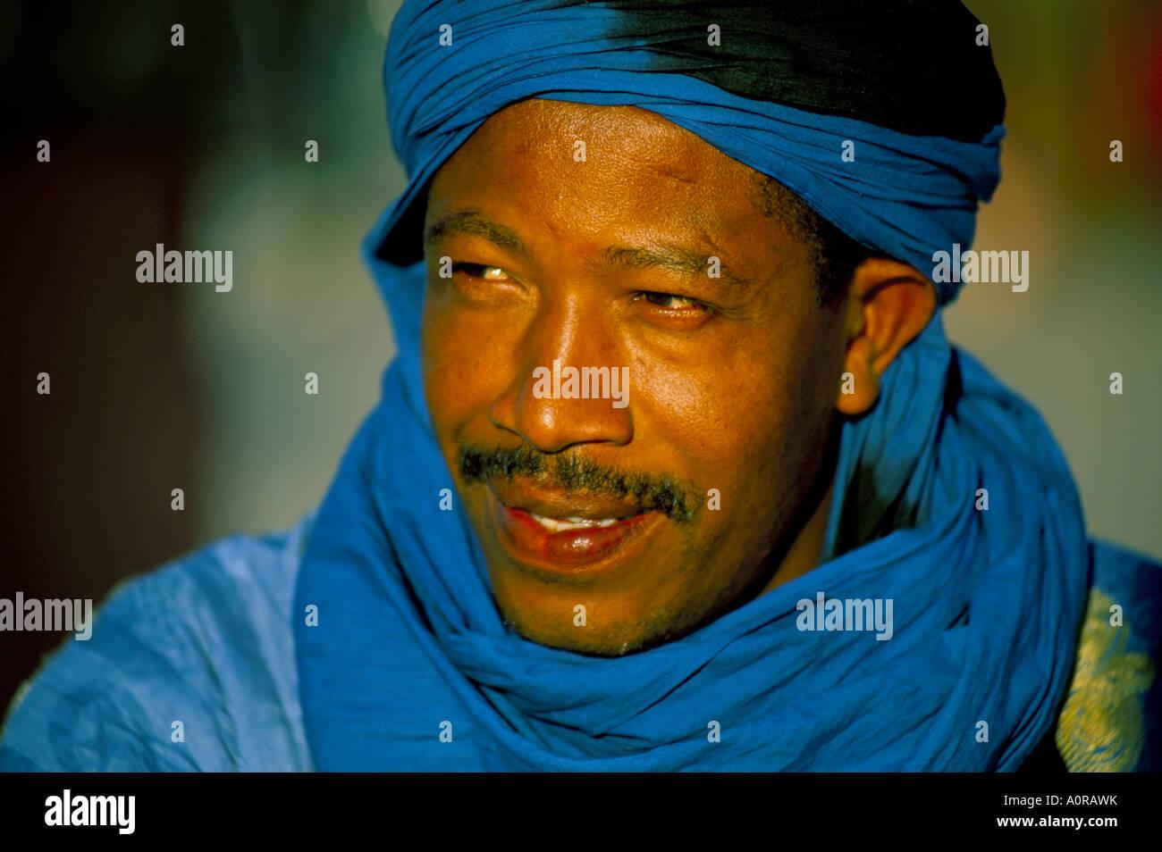 Man wearing blue headscarf Djemma el Fna Marrakech Marrakesh Morocco North Africa Africa - Stock Image
