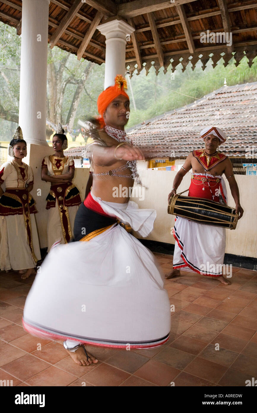 Kandyan Dance considered the National Dance of Sri Lanka the dancers are accompanied by drummers on the geta bera - Stock Image